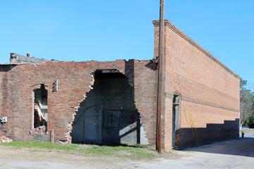 Abandoned and damaged brick building