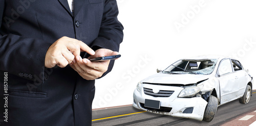 man using phone after accident, insurance concept poster