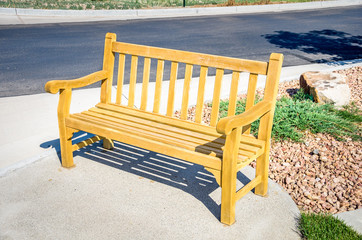 Wooden Bench on a Sidewalk