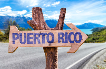 Puerto Rico wooden sign with road background