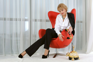 Business woman is holding a vintage phone handset
