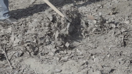 the man removes the rake garbage close up slow motion