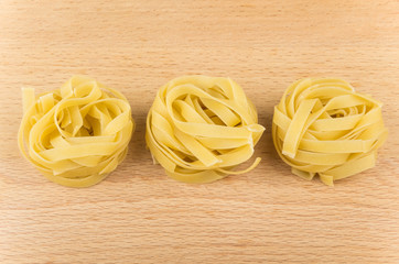 Pasta form nest in black dish on board
