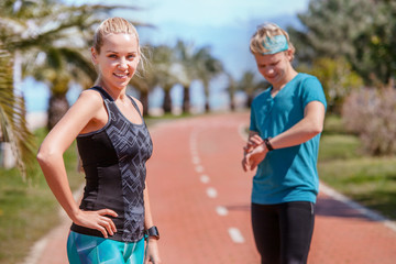 Young couple prepare to start jogging