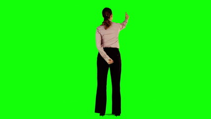 Businesswoman interacting with green screen