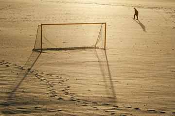 man walking and goal soccer on the beach in Galicia Spain