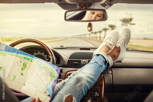 Young woman alone car traveler with map - 81575235