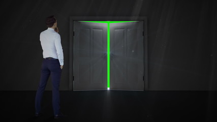 Door opening to green screen watched by businessman