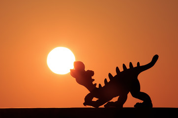 Dinosaur waiting for sunrise.