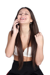 Young woman in bra speaking by phone