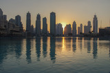Dubai sunset in front of the artificial lake outside the Dubai M