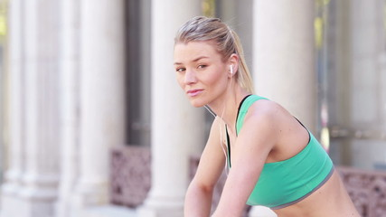 Pretty blonde jogger stretching