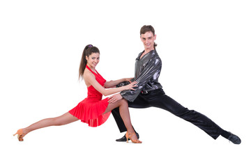 Full length of young ballet couple dancing on white background