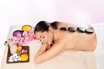 Spa. Beautiful young woman getting spa massage