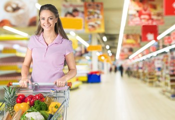 Supermarket. Pretty young woman smiles in supermarket fresh