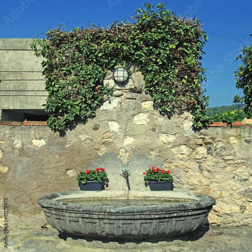 Leinwanddruck Bild Medieval stone water fountain