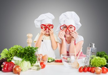 Kid. Mother and kid cooking and having fun in kitchen