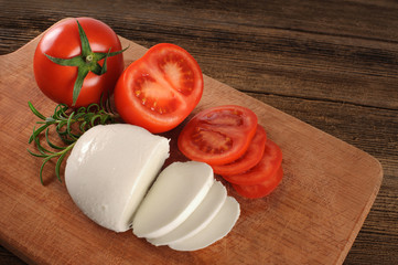 Mozzarella cheese with tomatoes and rosemary.