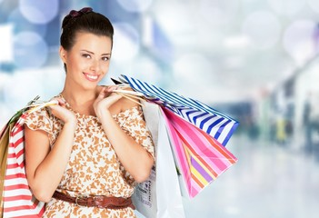 Shopping. Woman holding shopping bags