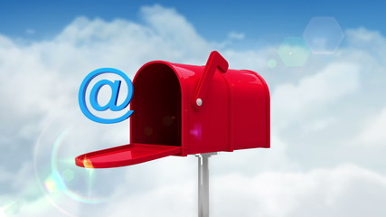 At symbol in the mailbox on cloudy background