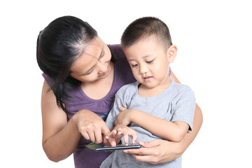 Mother and son playing video game on mobile phone