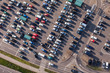 aerial view over crowded  parking lot near supermarket