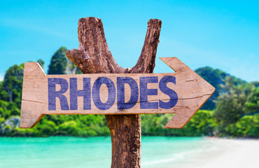 Rhodes wooden sign with beach background