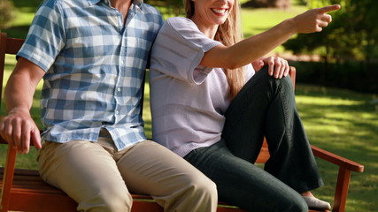 Couple relaxing in the park on bench