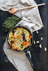 Pasta spaghetti with pesto sauce, basil, cherry-tomatoes, garlic