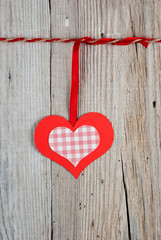 Paper heart on old wooden background