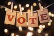 Leinwandbild Motiv Vote Concept Clipped Cards and Lights