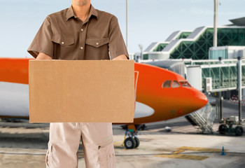 worker delivering package shipping by air
