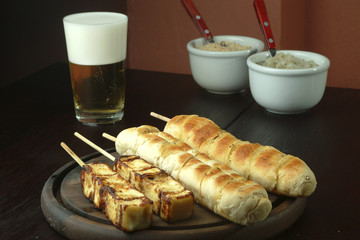 barbecue - bread and cheese  served on a stick.