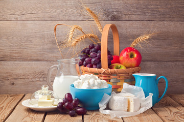 Milk, cheese and fruit basket, Jewish holiday Shavuot