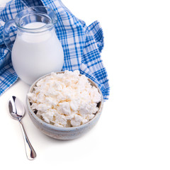 Milk and cottage cheese on white, Jewish holiday Shavuot