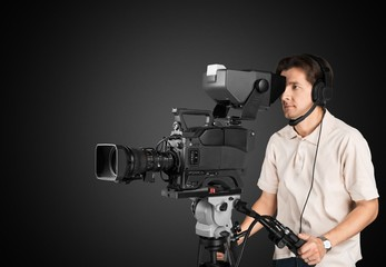 Film. Professional cameraman with headphones with HD camcorder