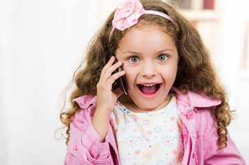 cute little girl using cell phone