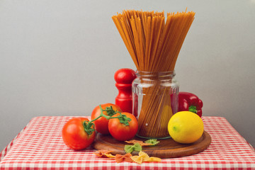 Healthy diet concept. Whole wheat spaghetti and vegetables