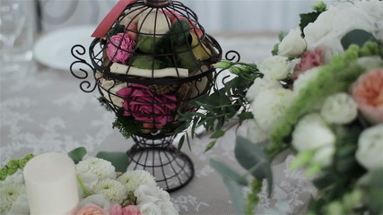 A wedding table decorated with flowers. Close-up