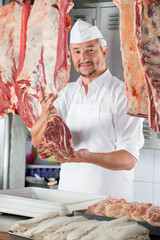 Confident Butcher Holding Raw Meat