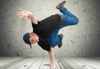 Breakdancing. Smiling breakdancer