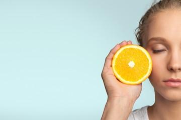 Fruit. Beautiful girl with juicy orange