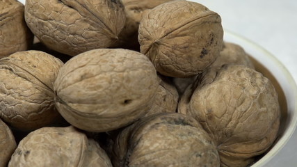 Not Shelled Walnuts in a Bowl