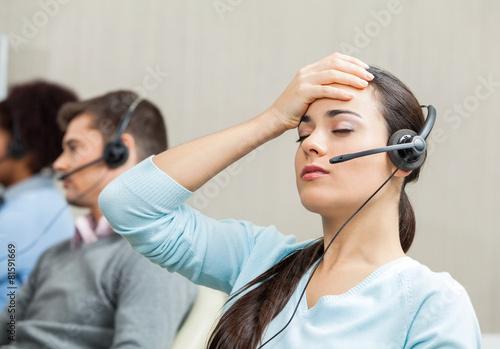 Leinwanddruck Bild Tired Female Customer Service Agent In Call Center