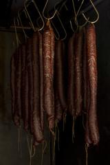 Smoked sausages hanging in smokehouse
