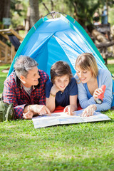 Happy Family Reading Map In Tent