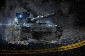 The modern battle tank moving at night in the rain on a mission