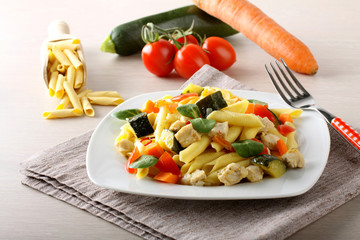 Pasta with swordfish, zucchini and cherry tomatoes