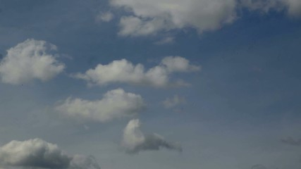 Timelapse. Big white clouds on a blue sky background