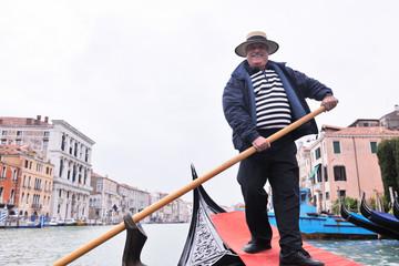 venice italy, gondola driver in grand channel
